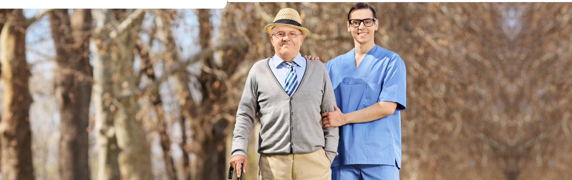 A caregiver accompanying an elderly for a walk outside